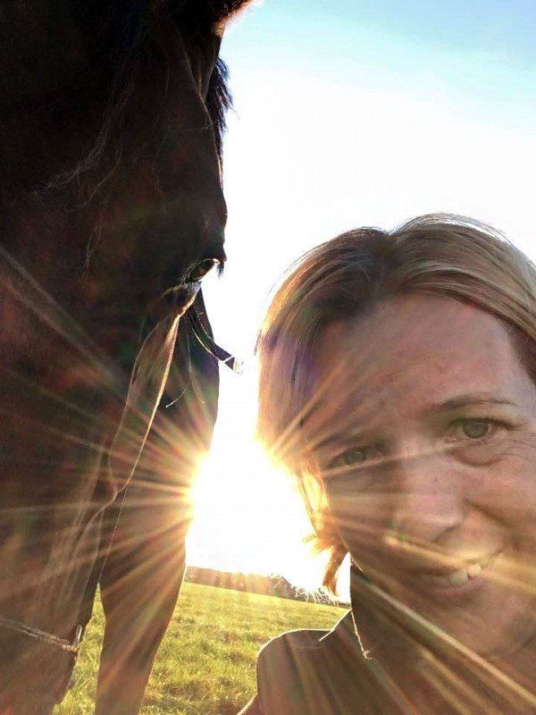 Rianne Sibma with horse in evening sun, Rottum, The Netherlands